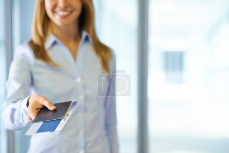 Office worker passing passport and ticket