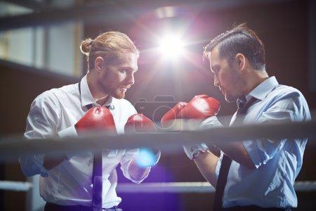 Businessmen in boxing glove