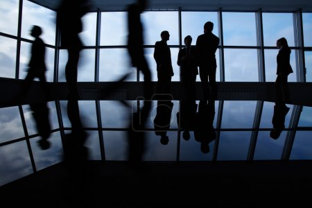 Photo for Outlines of business people, meeting, communicating and walking in office lobby - Royalty Free Image
