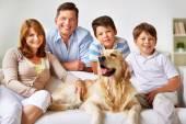 Family and Labrador dog