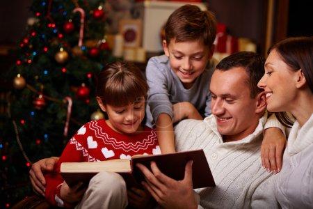 Family reading Christmas fairy tales