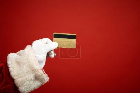 Santa hand holding plastic card