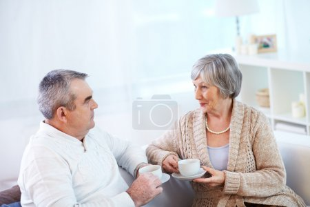 Senior couple with  cup of tea