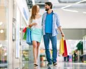 Couple walking in big mall