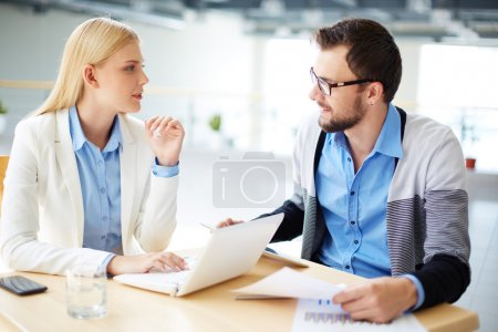 Photo for Two colleagues discussing ideas or project at meeting - Royalty Free Image