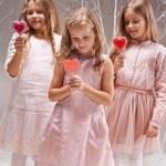 Постер, плакат: Girls with candy hearts
