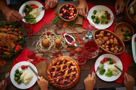 Photo for Hands of people over plates with festive food, top view - Royalty Free Image