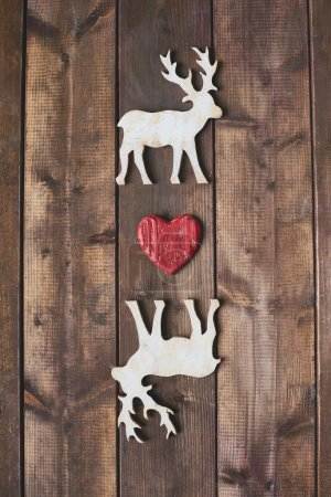 Wooden deer with red heart