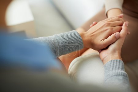 Photo pour Close-up of psychiatrist hands together holding palm of her patient - image libre de droit