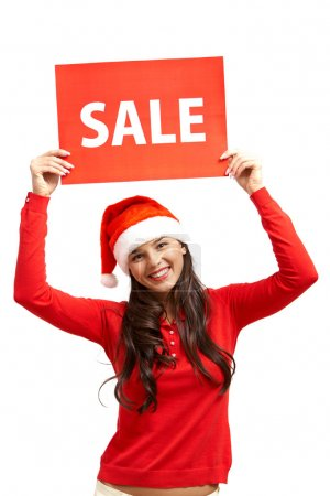 Girl in Santa cap showing red sale card