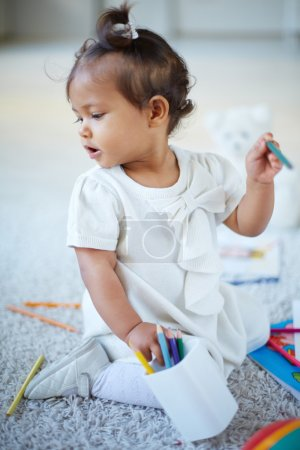 Little girl with colorful pencils