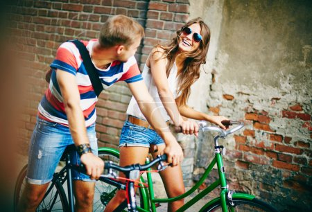 Couple riding on bicycles