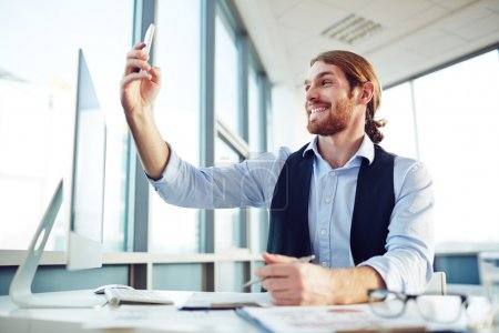 Businessman making selfie