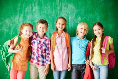 Group of pupils with backpacks