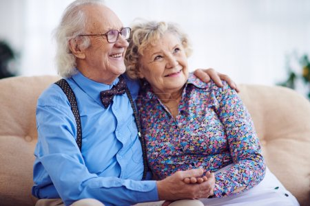 Aged couple in smart clothes
