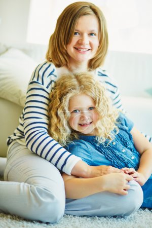 Photo for Young woman with her daughter posing at home - Royalty Free Image