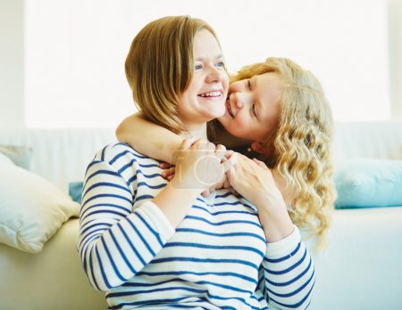 Photo for Portrait of cute girl embracing her mother - Royalty Free Image