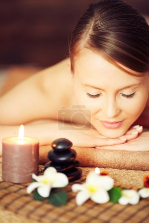Woman enjoying aromatherapy at spa