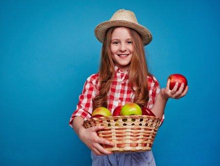Little girl with fruit basket