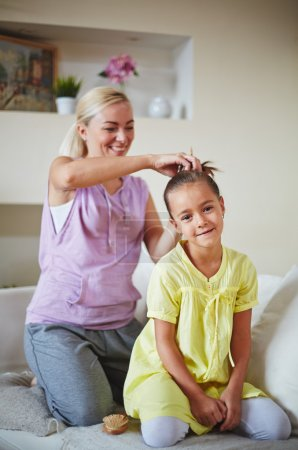 Photo for Mother making hairstyle for her daughter - Royalty Free Image