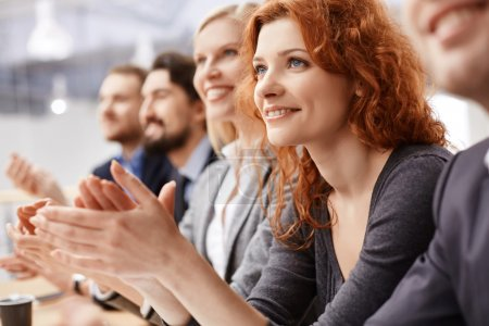 businesswoman applauding at conference