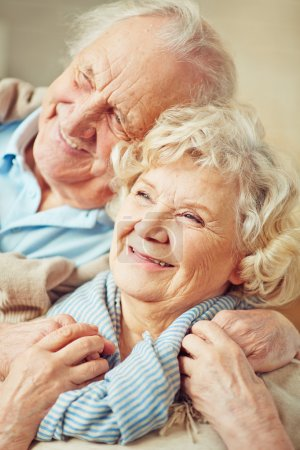 Happy elderly couple hugging