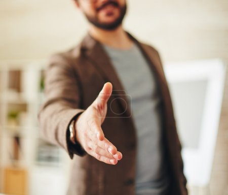 Photo for Businessman giving his hand for handshake to partner - Royalty Free Image