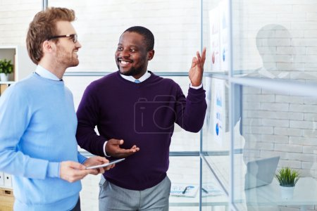 managers comparing financial reports