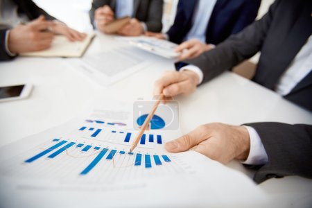 Businessman pointing at  financial data