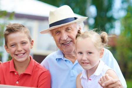 senior man with his two grandchildren
