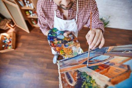 artist painting Venetian street
