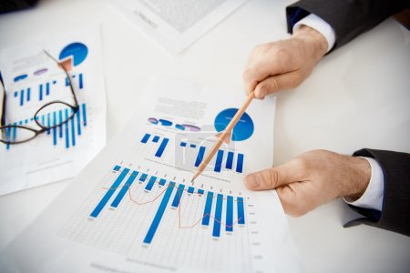 Businessman making financial report