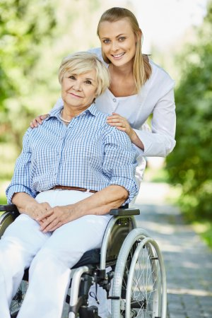 nurse and mature woman in wheelchair