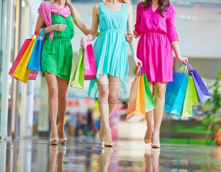 women in bright dresses   in mall