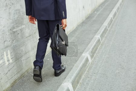 businessman legs going to work