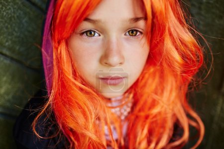 Calm girl with orange hair