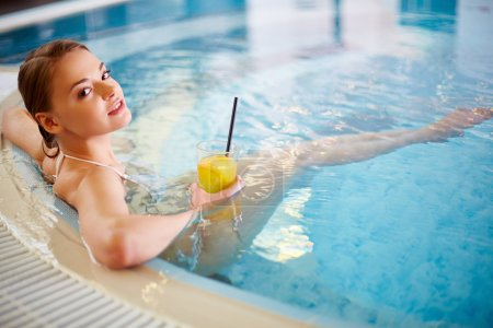 woman relaxing in swimming pool