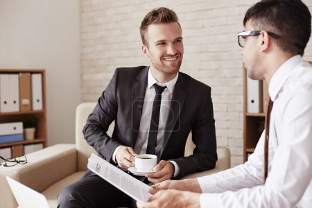 Photo for Modern businessmen communicating at meeting in office - Royalty Free Image