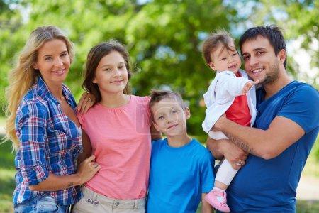 Happy couple with three children