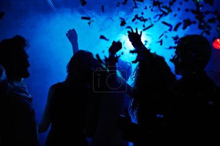 people dancing in confetti