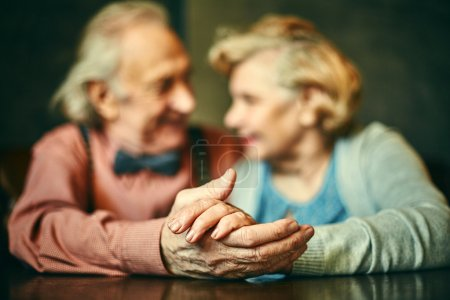 hands of senior couple