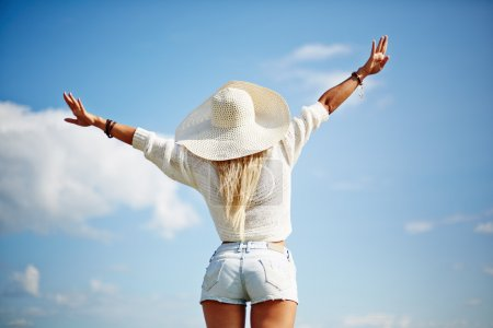 Photo for Rear view of woman with outstretched arms enjoying life - Royalty Free Image