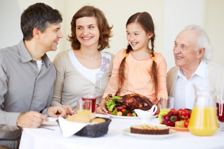 happy family with turkey at table
