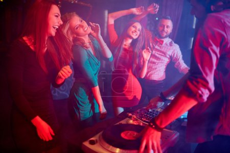 girls dancing by turntables