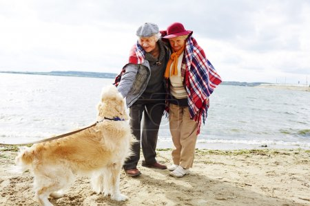 Happy pensioners and dog