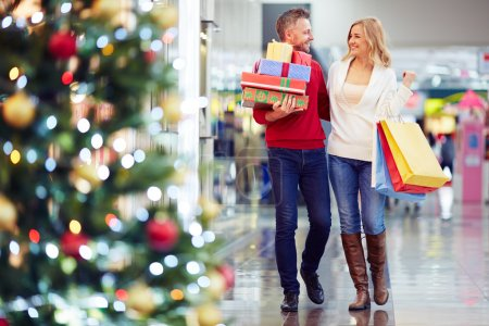 couple with Christmas presents in the mall