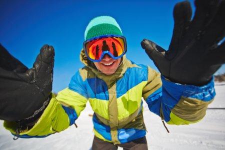 Sportsman snowboarding in winter