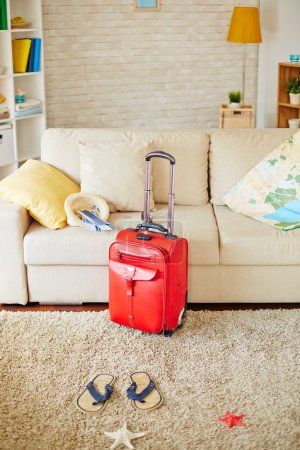 travel suitcase and map