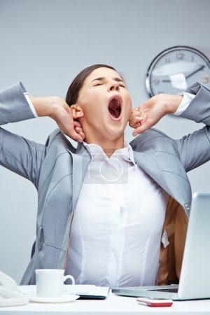 Businesswoman yawning at workplace