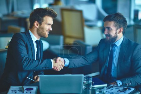 Photo for Successful young businessmen handshaking at meeting - Royalty Free Image